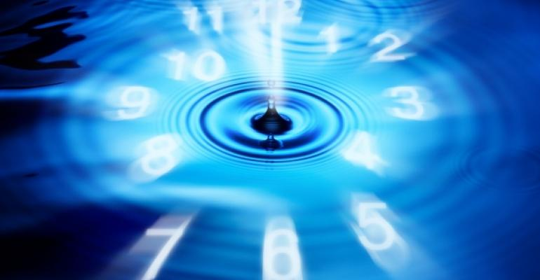 Blue abstract clock with white numbers and water drop in center
