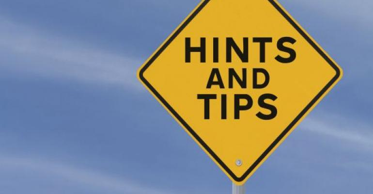 Hints and Tips yellow road sign