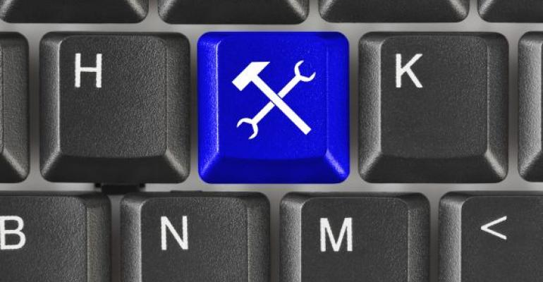 computer keyboard with blue tool key