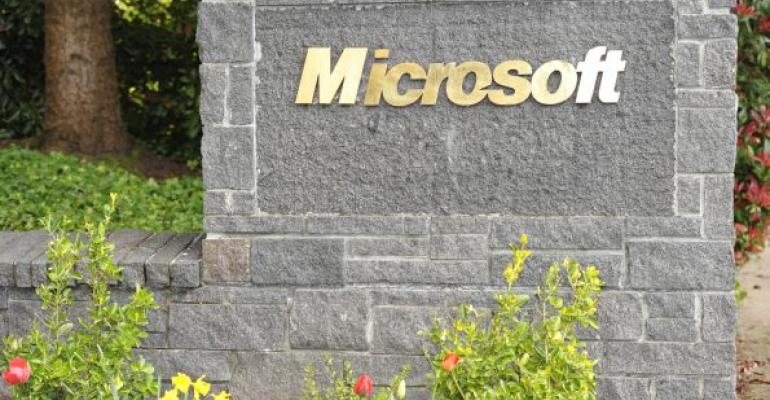 Stone sign with gold letters MICROSOFT