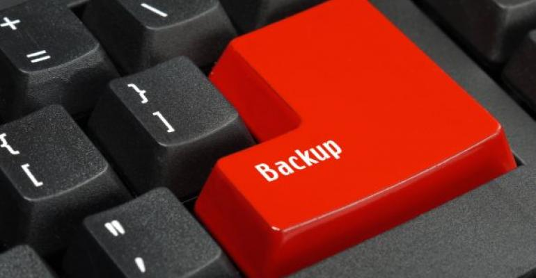 computer keyboard with red backup key