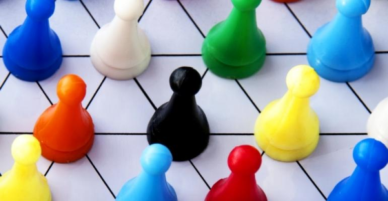 multicolored game pieces on white board with black lines connecting