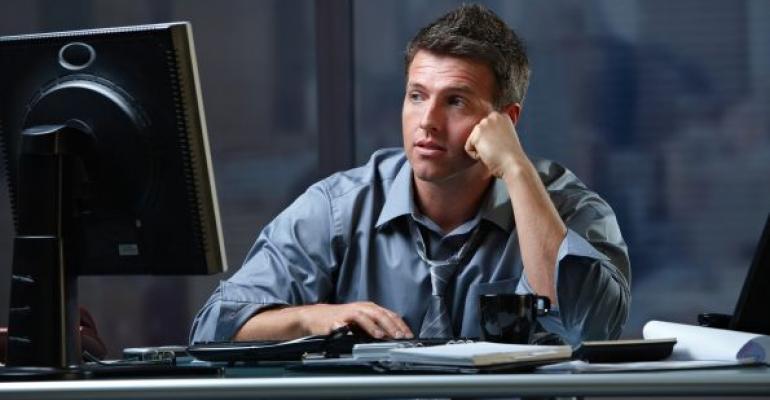 man looking at computer monitor