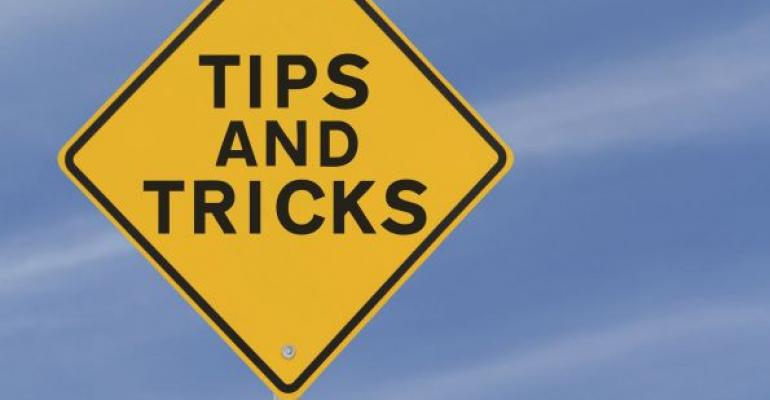 yellow road sign reading TIPS AND TRICKS