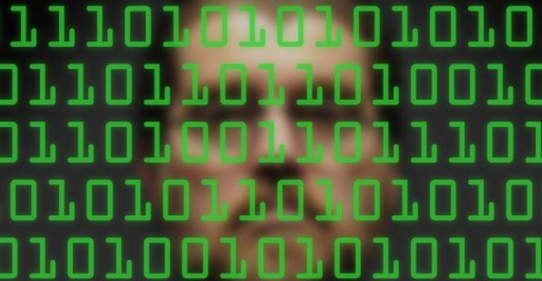 green binary code with mans face blurry in background