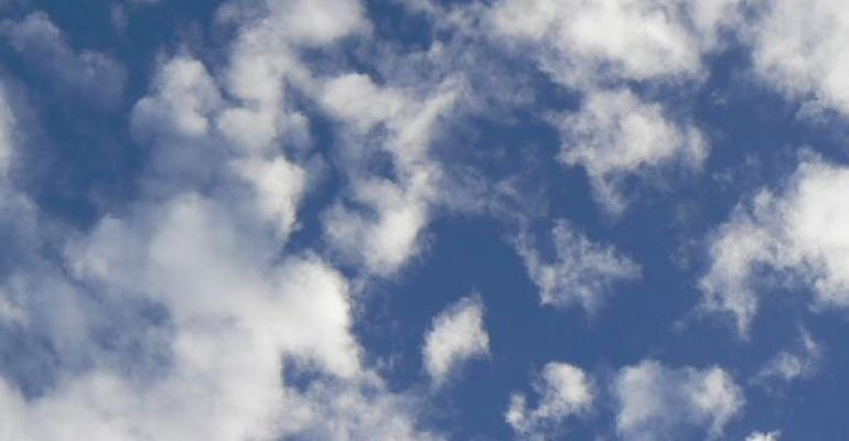 small white clouds against a blue sky