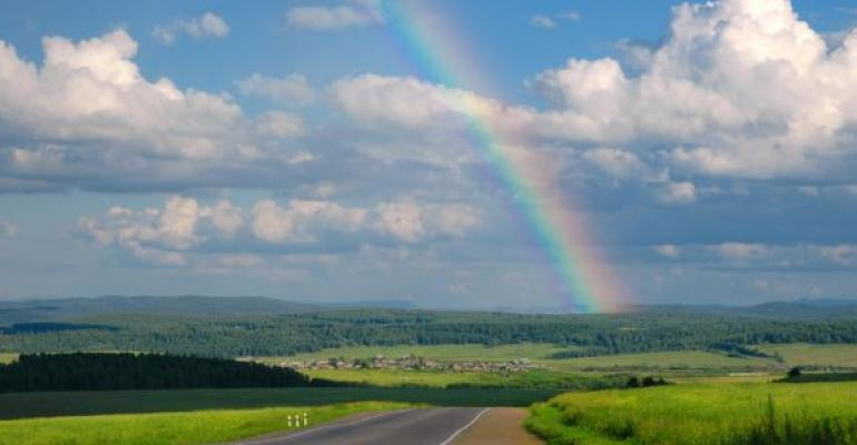 road with rainbow and clouds