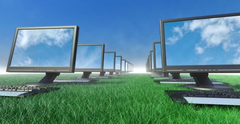 multiple computers in rows sitting on grass Blue sky background