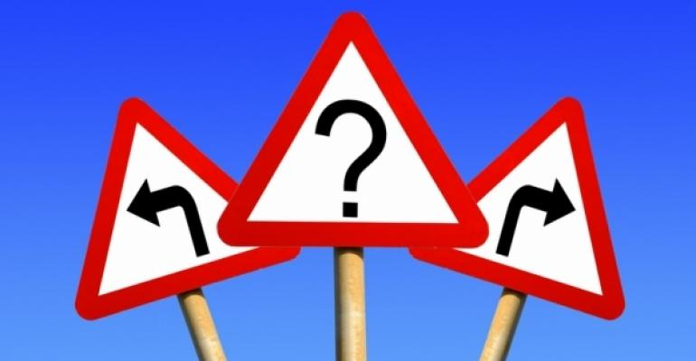 three road signs one with question mark other two with opposite facing arrows