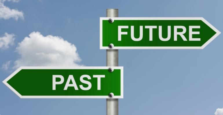 Green road signs reading FUTURE and PAST pointing opposite directions