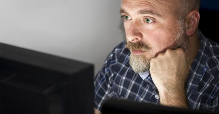 Man with mustache at computer