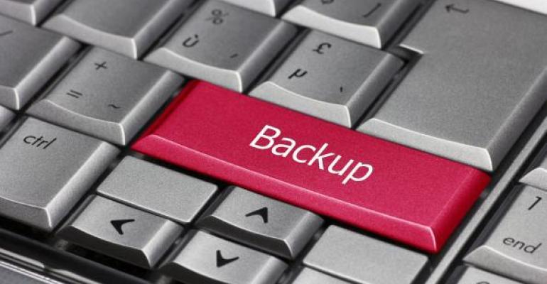 Red key labeled Backup on keyboard