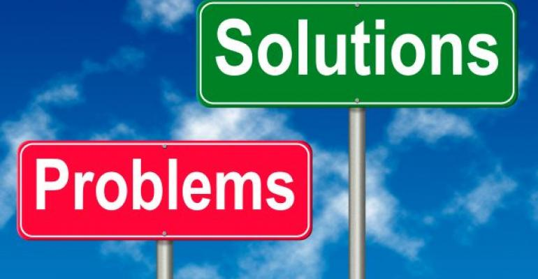 red and green road signs reading PROBLEMS and SOLUTIONS