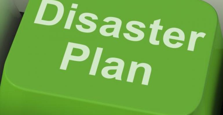 Disaster Plan written on green computer keyboard key