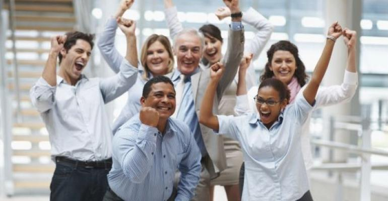 excited men and women in an office