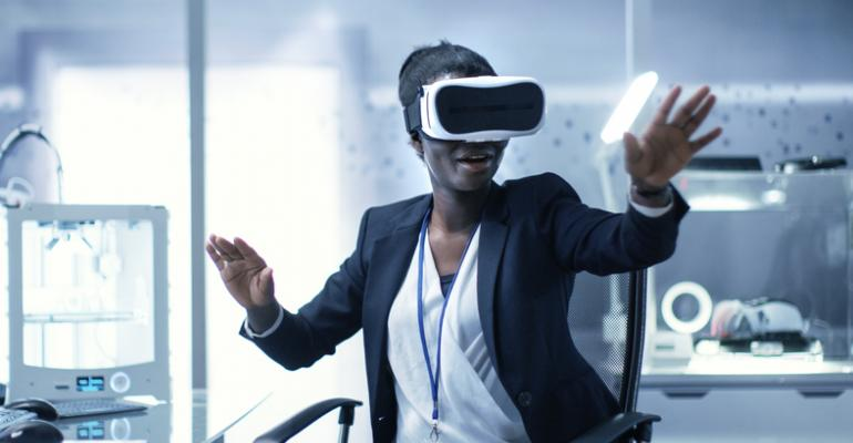 woman uses virtual reality headset at work