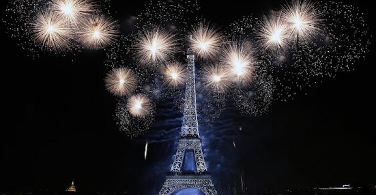 Fireworks explode in celebration all around the Eiffel Tower in Paris, France.