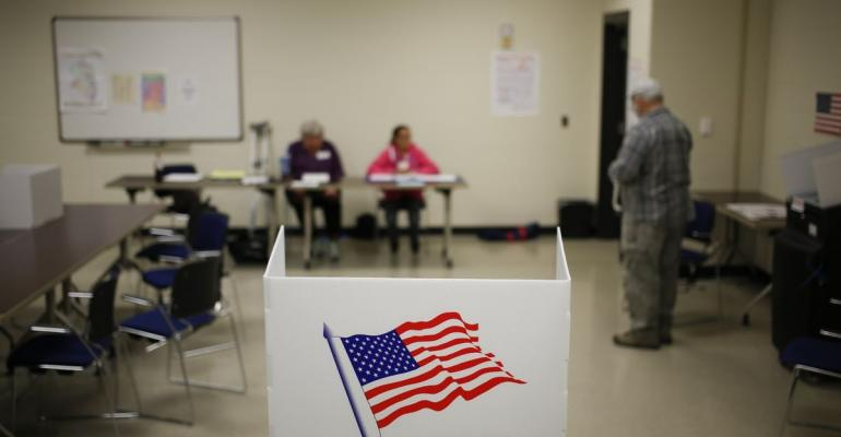 A voting booth stands at a polling station in the Kentucky National Guard Readiness Center in Burlington, Kentucky, U.S. Photographer: Luke Sharrett/Bloomberg