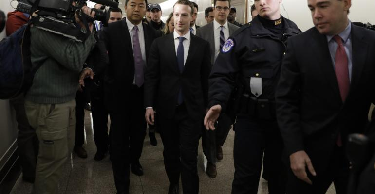 Mark Zuckerberg, chief executive officer and founder of Facebook Inc., center, arrives for a meeting with Senator John Thune, Republican from South Dakota, not pictured, on Capitol Hill in Washington, D.C., U.S., on Monday, April 9, 2018. Zuckerberg, in prepared testimony for the U.S. House of Representatives, said all of Facebook's problems are his mistake. Photographer: Yuri Gripas/Bloomberg