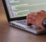 Person coding on a computer.png