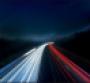 Light trails on highway at night.