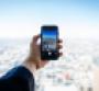 Phone against skyscraper backdrop