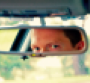 Face in rearview mirror