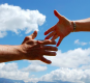 Handshake in front of cloud