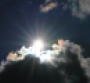 Sun coming though clouds.png