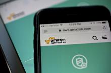 The Amazon.com Inc. Amazon Web Services (AWS) Shield website is displayed on an Apple Inc. iPhone and iPad in Washington, D.C., U.S., on Monday, Dec. 5, 2016.  Photographer: Andrew Harrer/Bloomberg