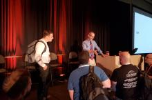 Microsoft Technical Fellow Jeffrey Snover (Center in tie) talks to Microsoft Ignite attendees