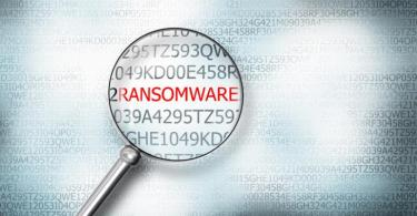 Illustration of a magnifying glass focused on the word ransomware
