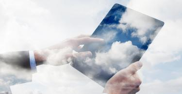worker using tablet filled with clouds