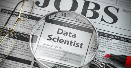 Data scientist vacancy in the ad of job search newspaper with loupe