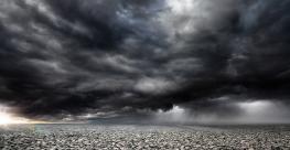 Stormy rocky background with dark clouds