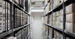 Boxes stored on metal racks