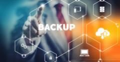 "businessman selecting ""backup"" from modern virtual interface"