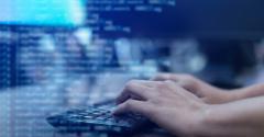 developer typing code onto a computer screen