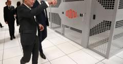 French Economy Minister Bruno Le Maire (R) listens to Regis Castagne (L), managing director of Southern European Equinix Data Center, during the inauguration of the Equinix data center in a suburb of Paris called PA8.