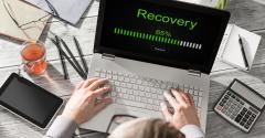 man using laptop with recovery on the screen.jpg