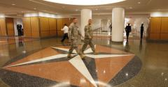 People walk through a newly-renovated corridor at the Pentagon in Arlington, Virginia, U.S. Photographer: Rich Clement/Bloomberg