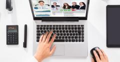 employee working remotely video calling