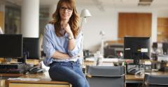 Woman sitting on her desk in office