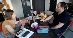Two parents telework from home with their two boys aged two and seven years, due to schools closing because of the Coronavirus outbreak on March 19, 2020 in 15th district of Paris.