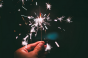 Person holding sparkler.png