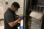 A CoreSite engineer testing a cross-connect for acceptable light loss at the company's data center in Chicago.