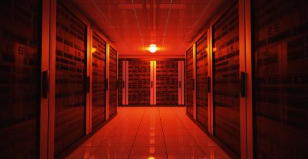 A dimly lit data center representing an outage