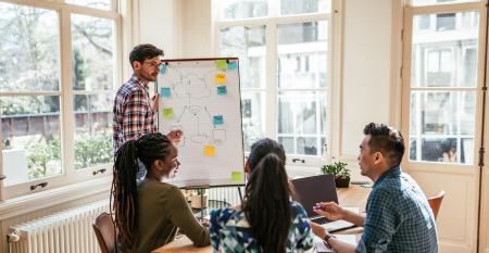 Multi-ethnic millennial business team - presentation of blockchain scheme in the office stock photo.jpg