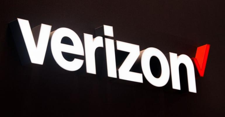 BARCELONA, SPAIN - FEBRUARY 27:  A logo sits illuminated outside the Verizon pavilion during the Mobile World Congress 2017 on the opening day of the event at the Fira Gran Via Complex on February 27, 2017 in Barcelona, Spain. The annual Mobile World Congress hosts some of the world's largest communications companies, with many unveiling their latest phones and wearables gadgets.  (Photo by David Ramos/Getty Images)