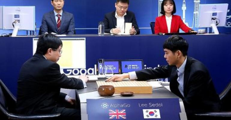 South Korean professional Go player Lee Se-Dol puts his first stone against Google's Artificial Intelligence program, AlphaGo, in March 2016 in Seoul. He lost the five-match series.